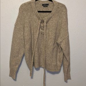 Knit sweater with tie detail